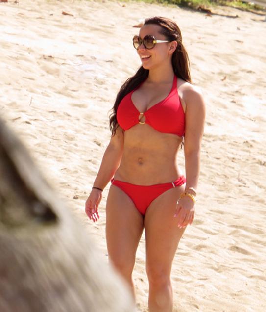 Adrienne Bailon flaunts her body