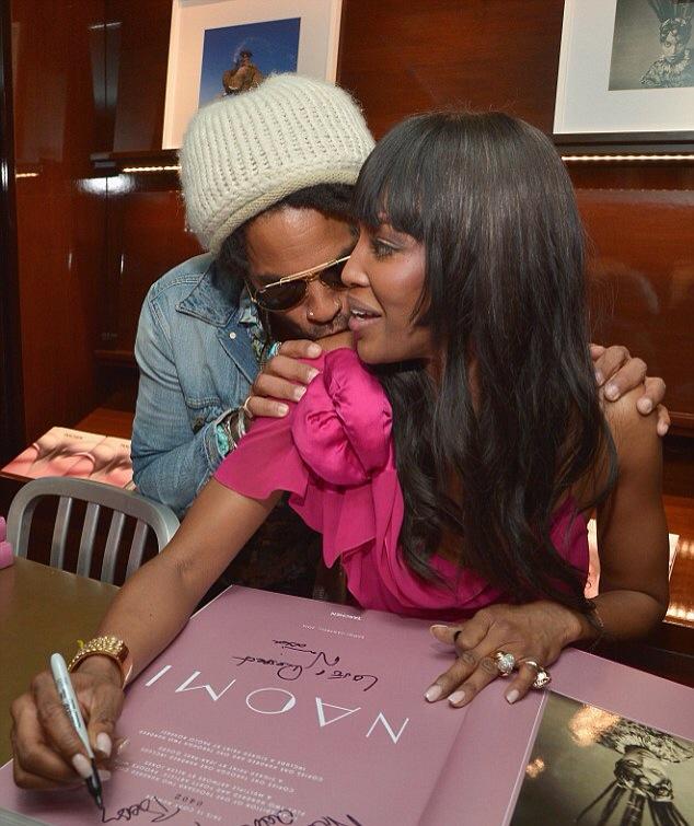 Naomi Campbell and Lenny Kravitz kissing her shoulder