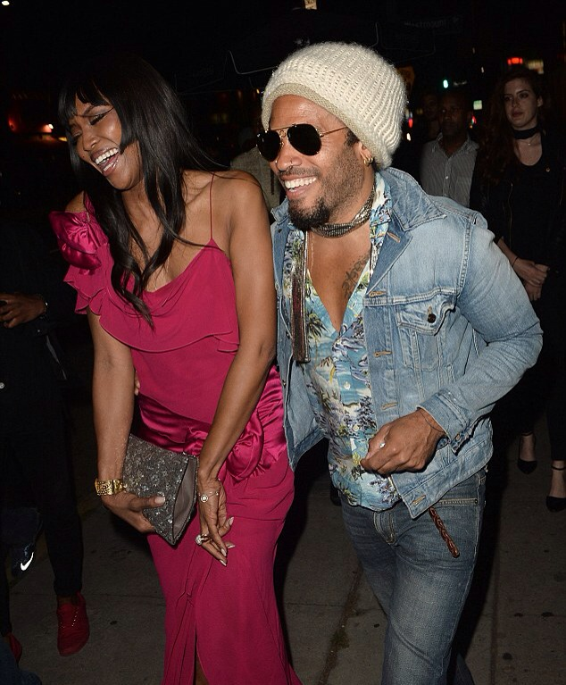 Naomi Cambell and Lenny Kravitz laughing