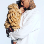 Chris Brown puts his daughter Royalty's face on his back