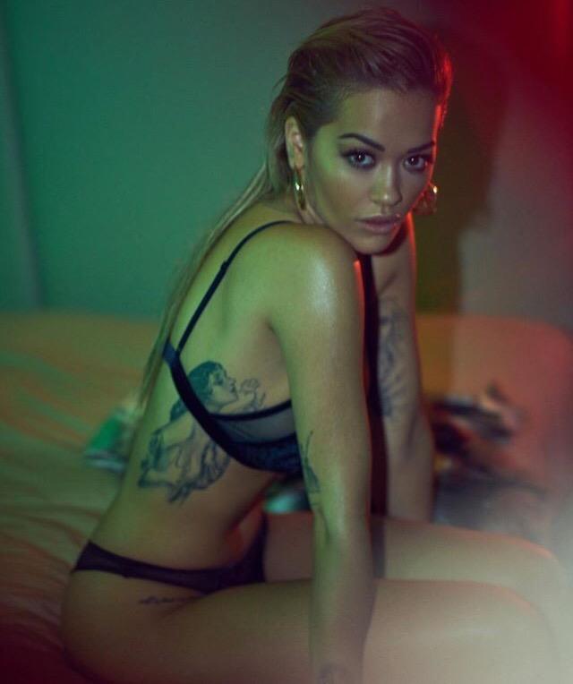 Rita Ora posing in black lingerie