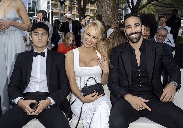 Brandon Lee, Pamela Anderson, Adil Rami at Cannes